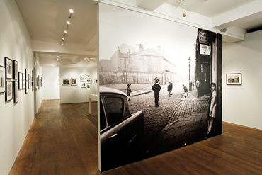 Image of the exhibition showing the opening wallpaper